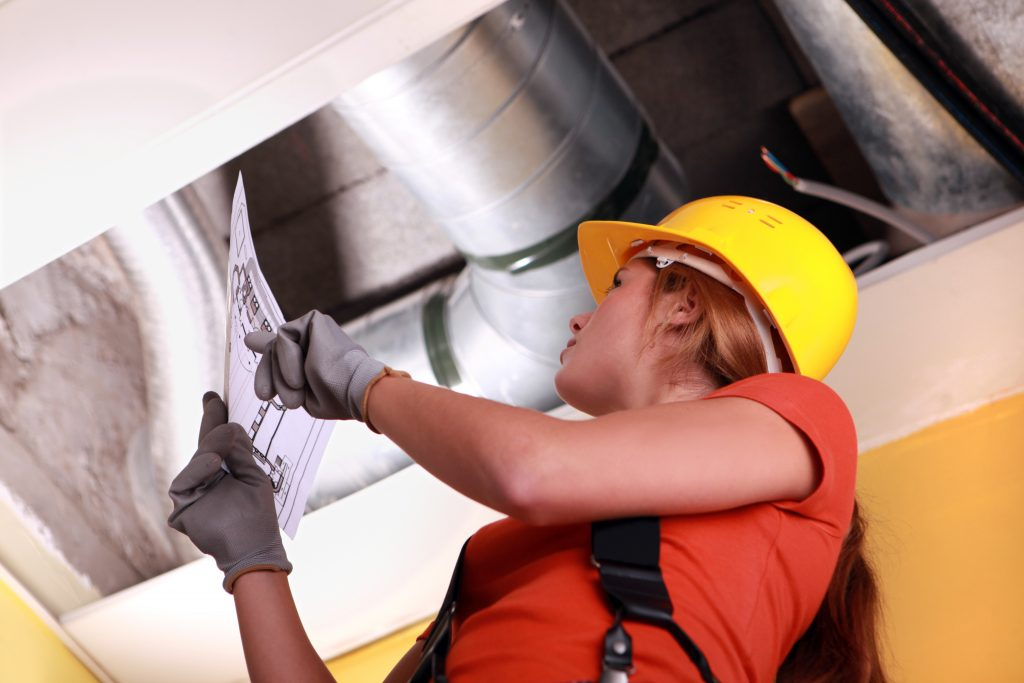Woman checking ventilation system